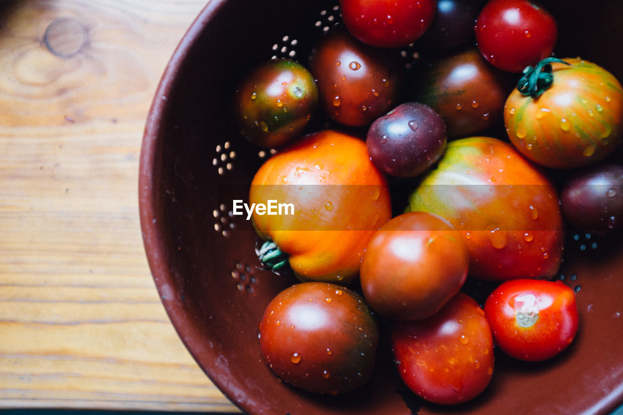High angle view of wet tomatoes in container
