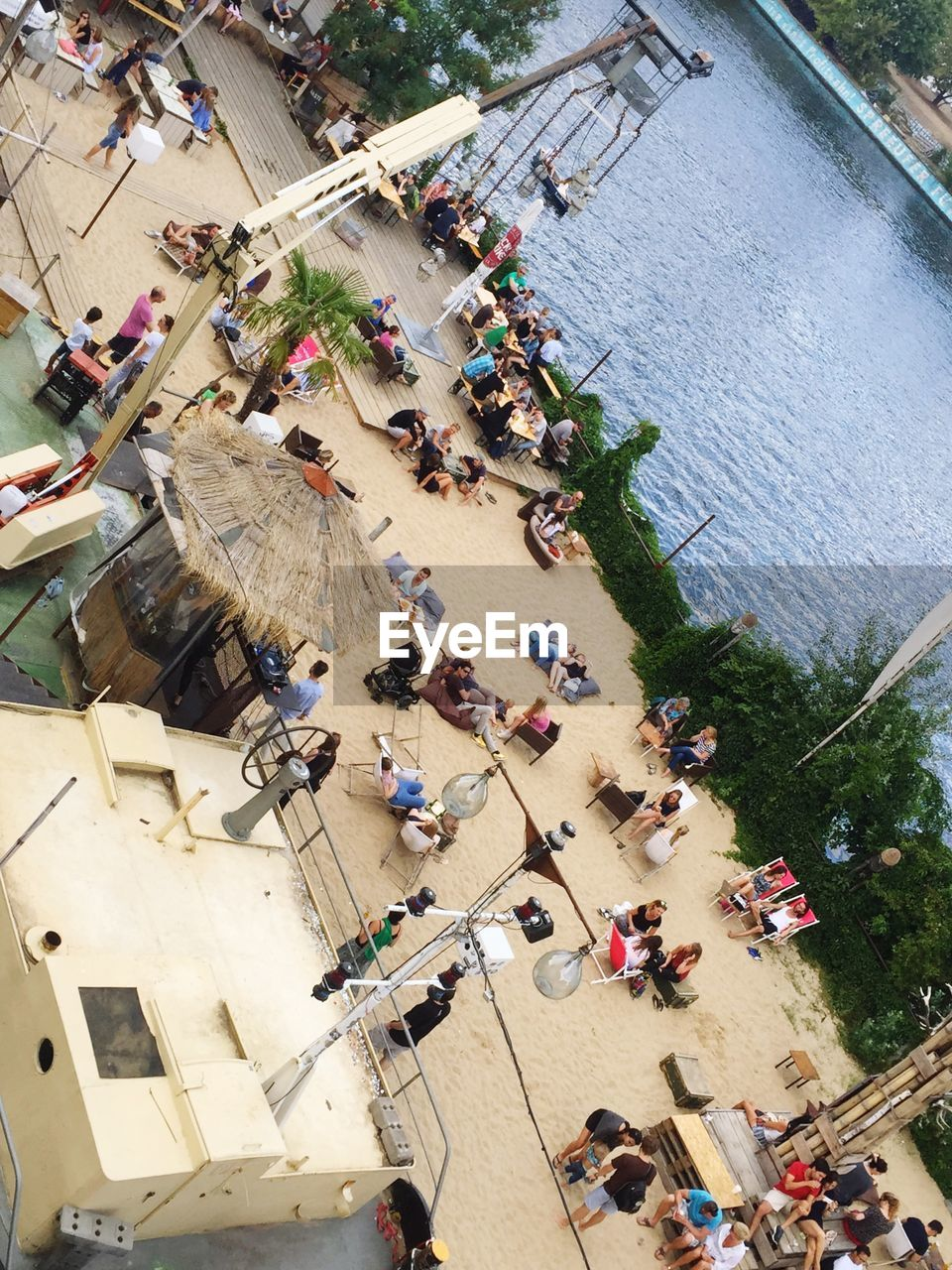 large group of people, high angle view, crowd, day, outdoors, real people, built structure, men, women, leisure activity, group of people, building exterior, architecture, nature, tree, city, people