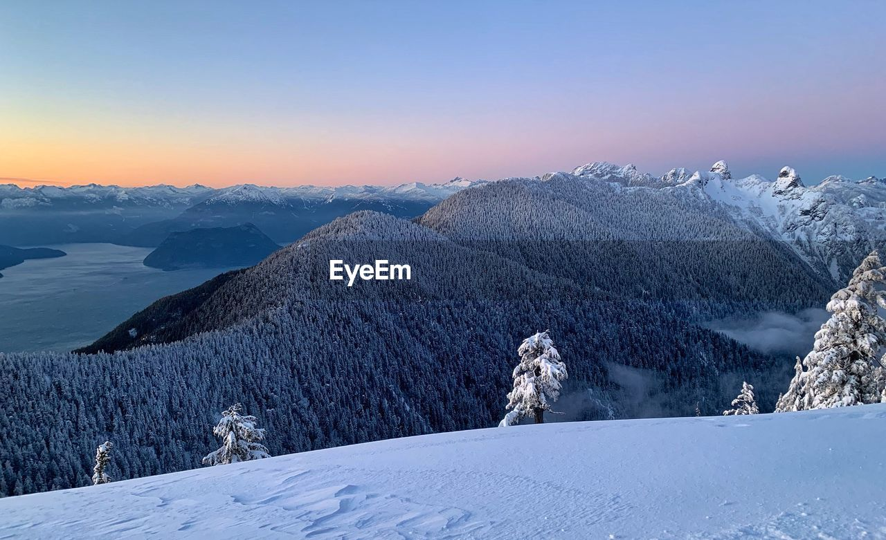 cold temperature, winter, snow, sky, beauty in nature, scenics - nature, tranquil scene, mountain, tranquility, environment, nature, landscape, white color, non-urban scene, sunset, mountain range, idyllic, covering, no people, snowcapped mountain, mountain peak