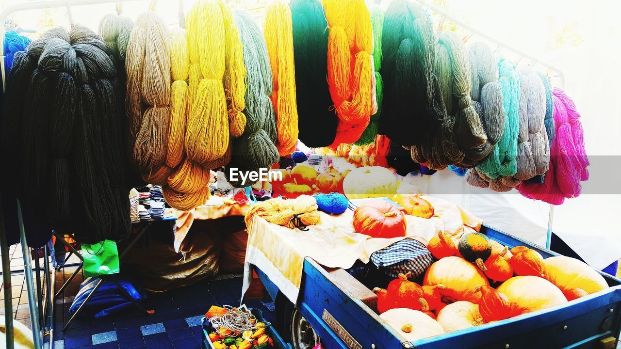 multi colored, choice, variation, retail, for sale, art and craft, market, creativity, large group of objects, still life, small business, textile, market stall, no people, high angle view, wool, business, abundance, indoors, day, retail display, scarf, street market