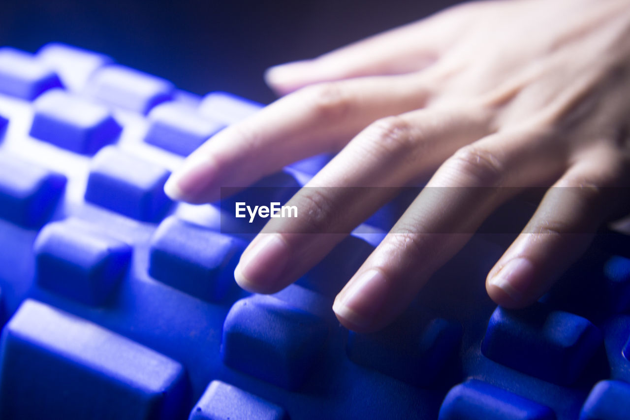 human hand, hand, finger, human finger, human body part, blue, body part, connection, technology, communication, computer equipment, computer, computer keyboard, keyboard, real people, close-up, wireless technology, indoors, one person, typing, computer key, purple, push button