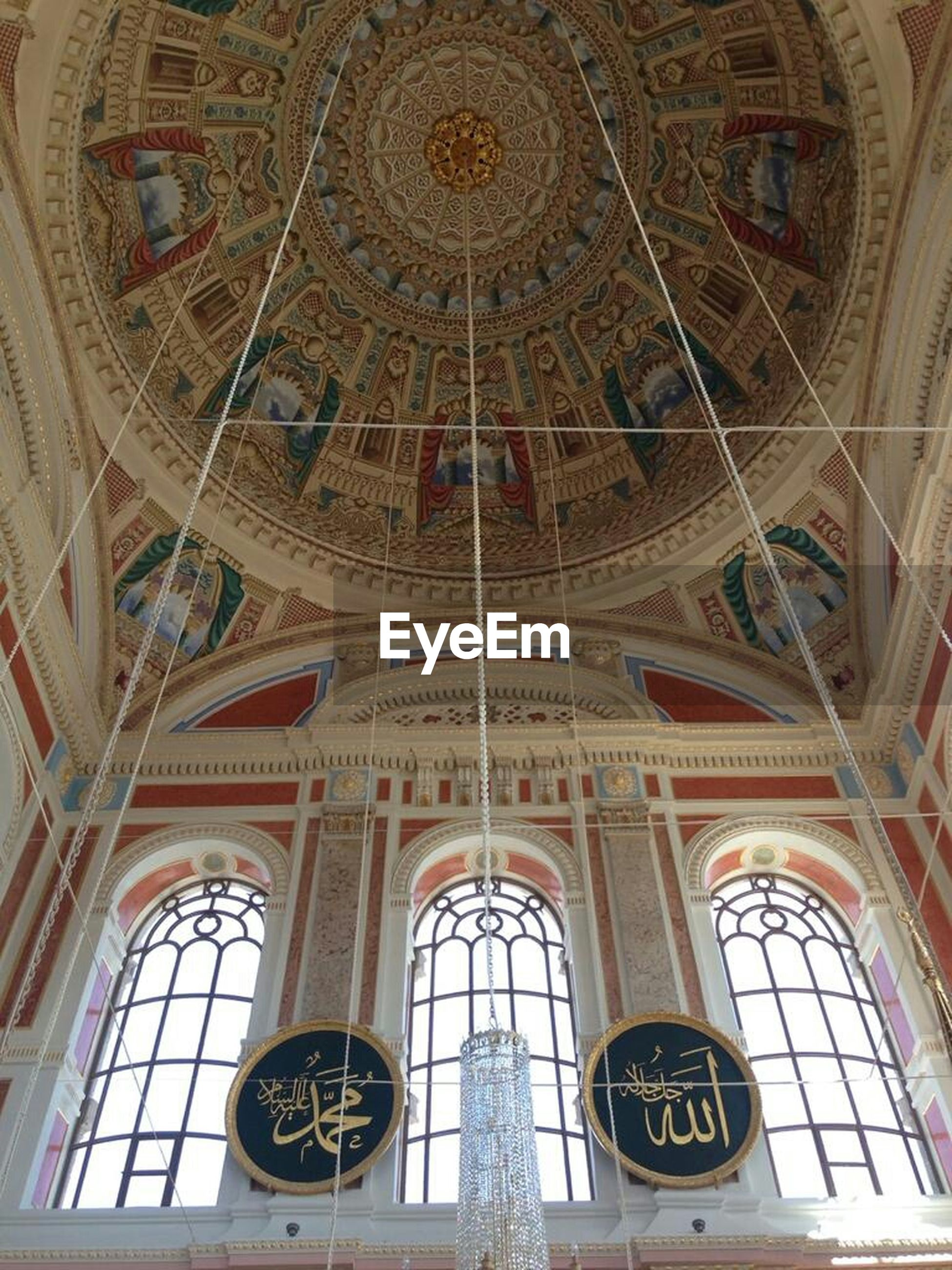 low angle view, indoors, architecture, built structure, place of worship, religion, church, ceiling, clock, ornate, spirituality, time, architectural feature, art and craft, pattern, design, cathedral, no people