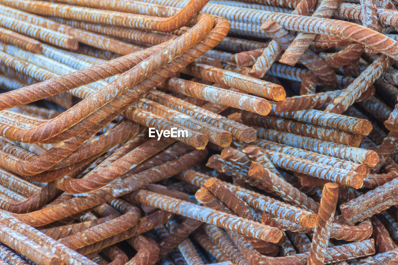 backgrounds, no people, full frame, large group of objects, strength, close-up, rusty, abundance, rope, day, high angle view, still life, heap, stack, metal, brown, pattern, in a row, outdoors, obsolete