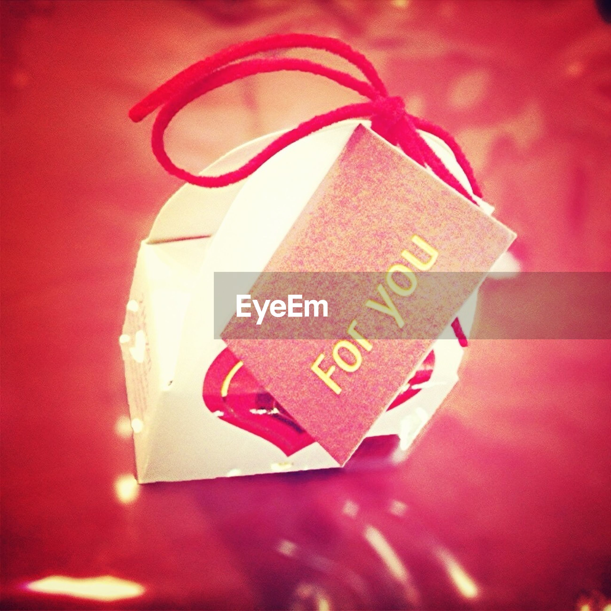 text, western script, indoors, communication, red, close-up, still life, message, table, paper, heart shape, love, capital letter, non-western script, no people, pink color, high angle view, number, handwriting, sign