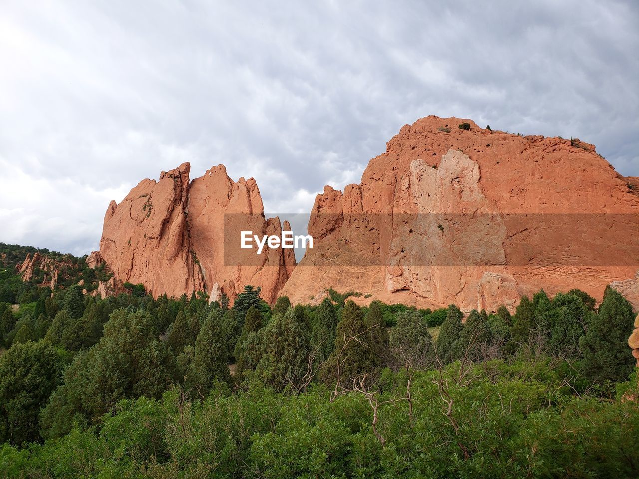 View Of Rocks And Trees On Rock Against Sky