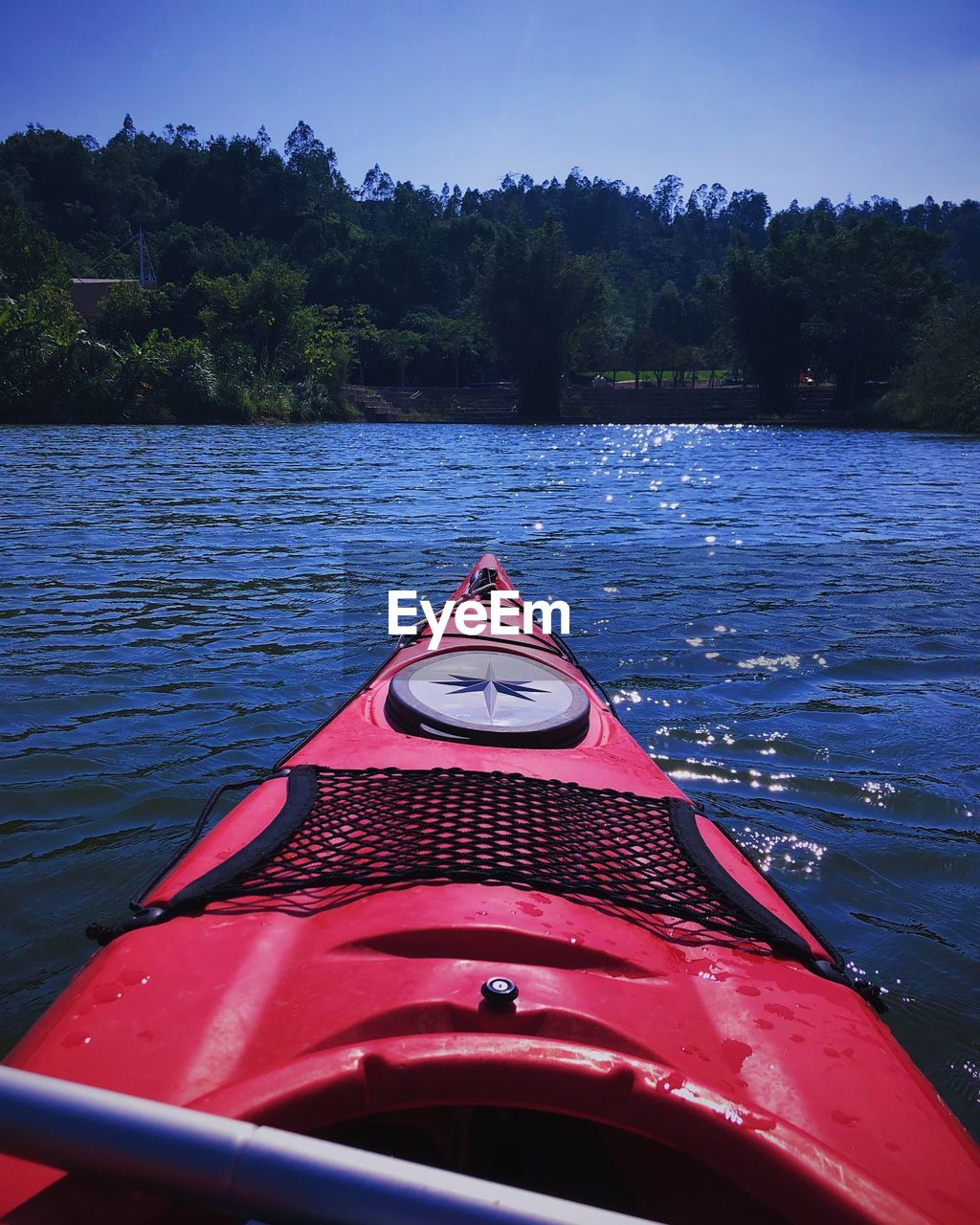 water, tree, transportation, plant, mode of transportation, nautical vessel, red, nature, lake, day, beauty in nature, sky, no people, kayak, scenics - nature, tranquility, outdoors, adventure, inflatable, rowboat