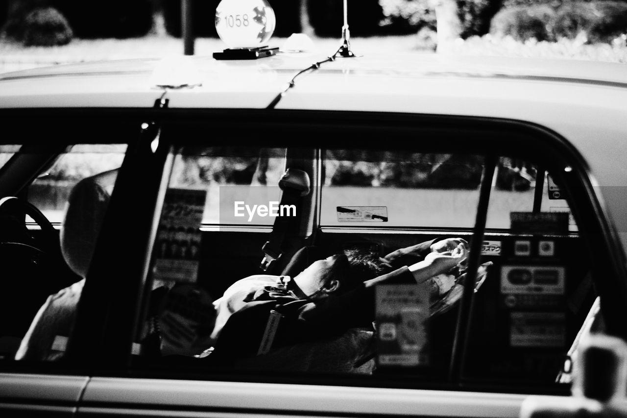 Woman driver sleeping in taxi