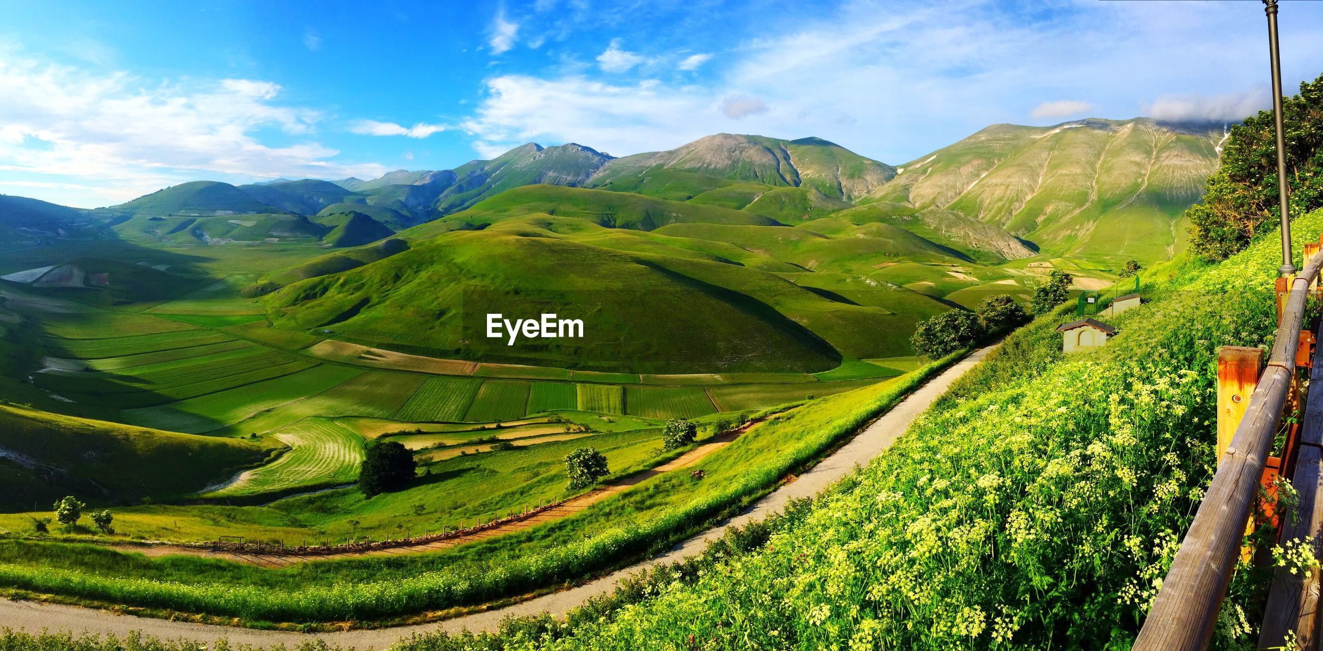 landscape, mountain, green color, tranquil scene, tranquility, sky, scenics, agriculture, beauty in nature, rural scene, field, grass, nature, farm, mountain range, growth, cloud - sky, cloud, tree, green