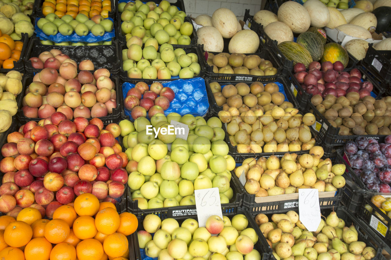 Various Fruits In Crates For Sale At Market Stall