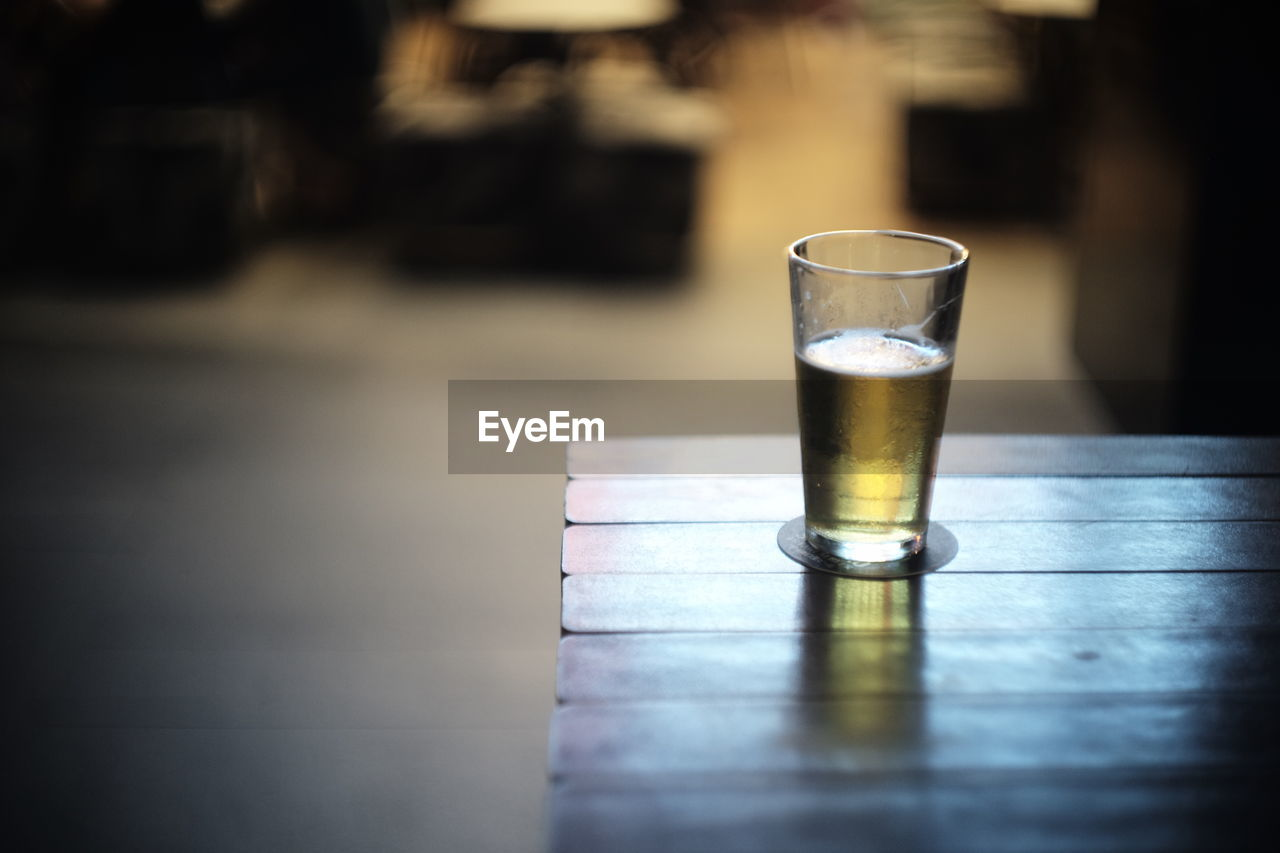 glass, refreshment, food and drink, drinking glass, drink, table, household equipment, freshness, day, close-up, still life, focus on foreground, selective focus, no people, outdoors, nature, transparent, wood - material, glass - material, non-alcoholic beverage