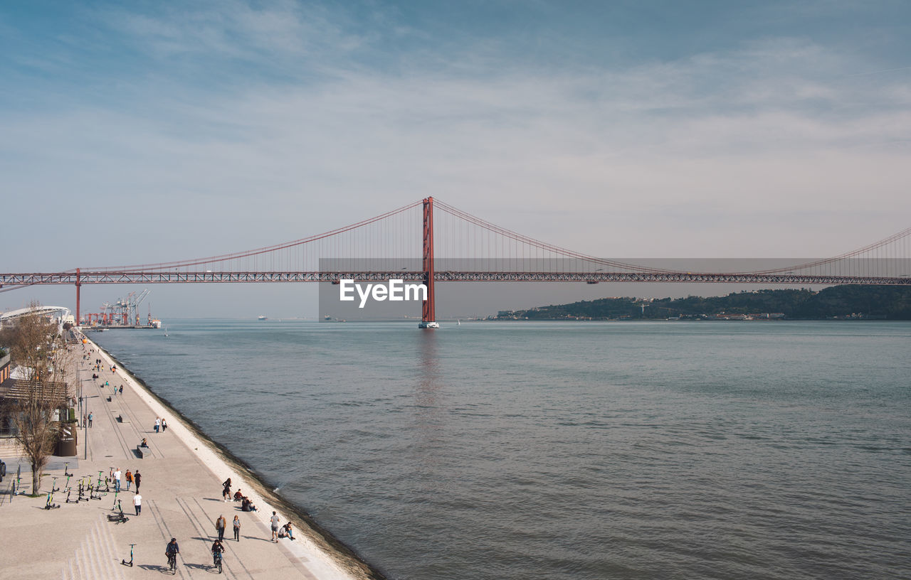 water, built structure, bridge, connection, architecture, sky, bridge - man made structure, transportation, suspension bridge, cloud - sky, sea, engineering, travel destinations, tourism, nature, bay of water, bay, day, travel, outdoors, long