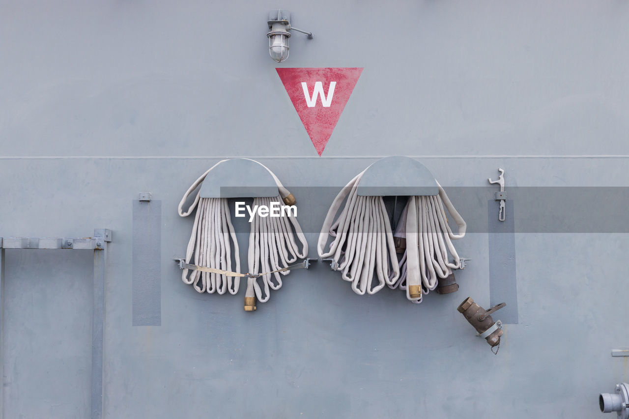 CLOSE-UP OF HEART SHAPE HANGING ON METAL WALL