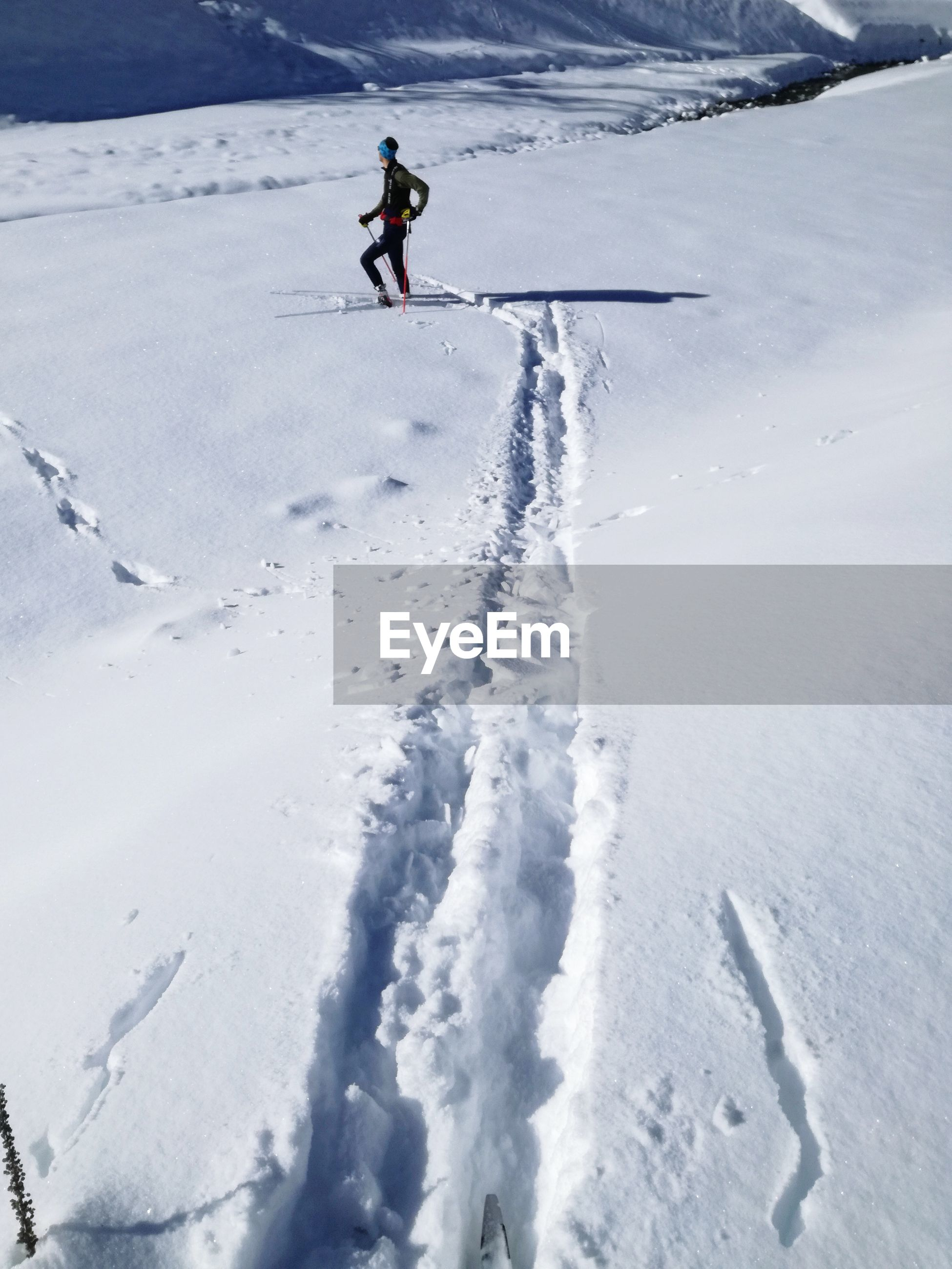 Person skiing on snow covered field