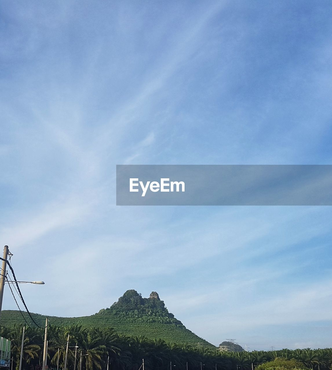 sky, beauty in nature, scenics - nature, tranquility, tranquil scene, plant, cloud - sky, nature, mountain, day, non-urban scene, environment, landscape, blue, no people, land, tree, green color, idyllic, outdoors, mountain peak