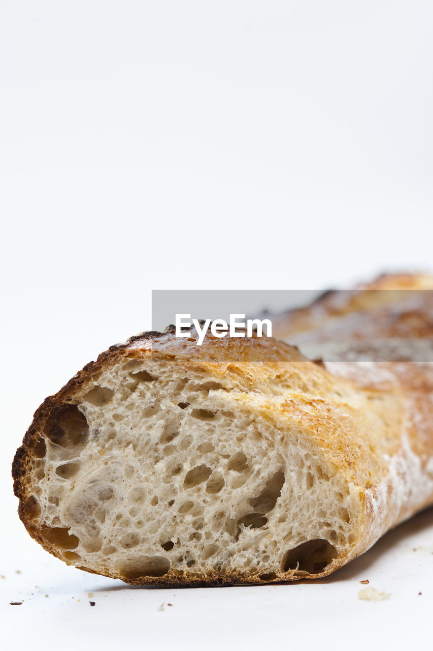 CLOSE-UP OF BREAD IN WHITE BACKGROUND