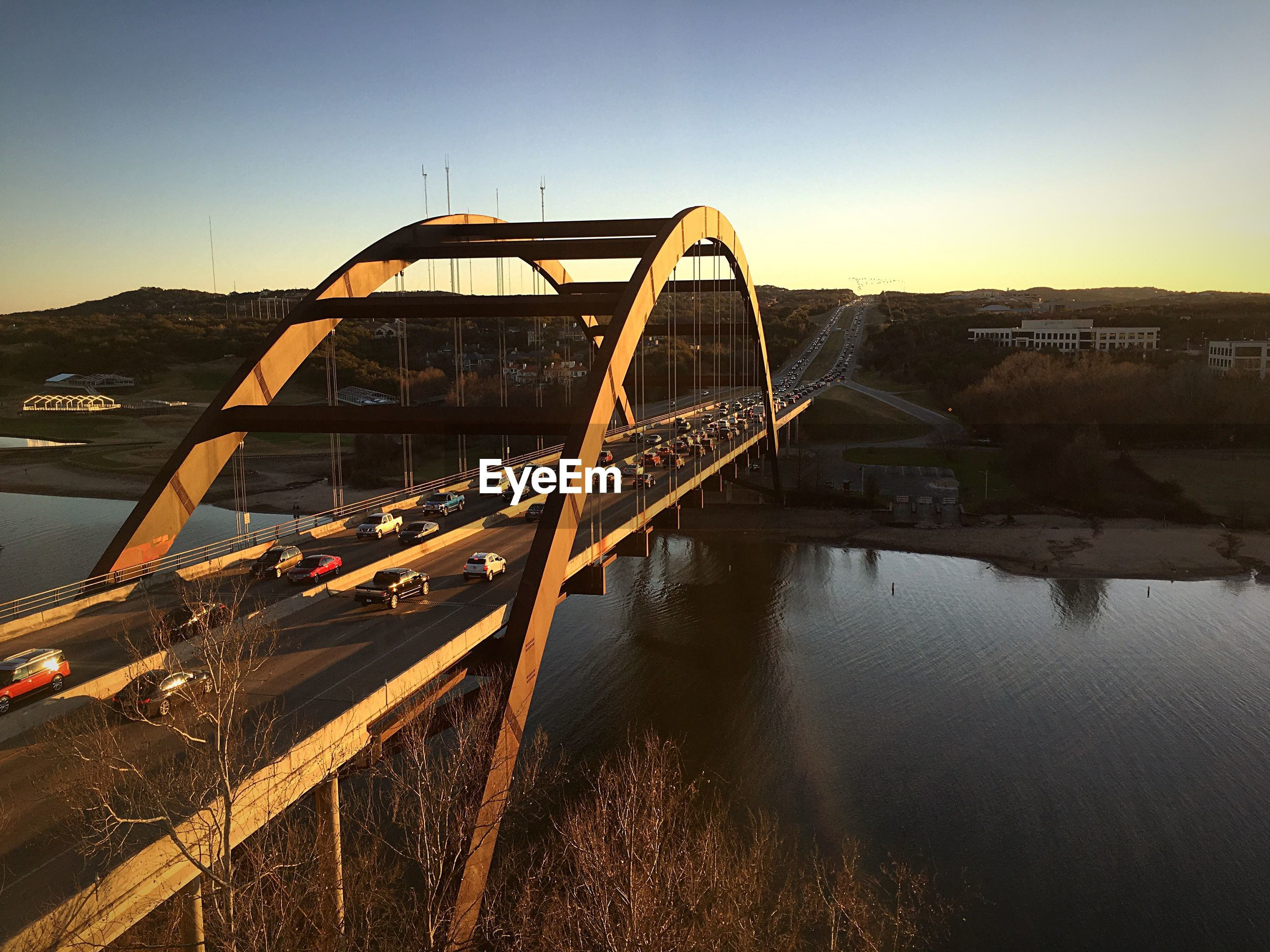 VIEW OF BRIDGE OVER RIVER AGAINST CLEAR SKY
