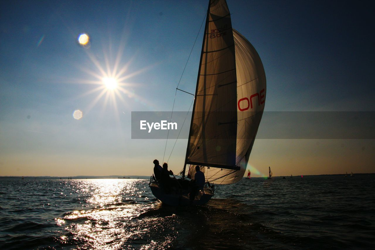 Boat Sailing On Sea During Sunset