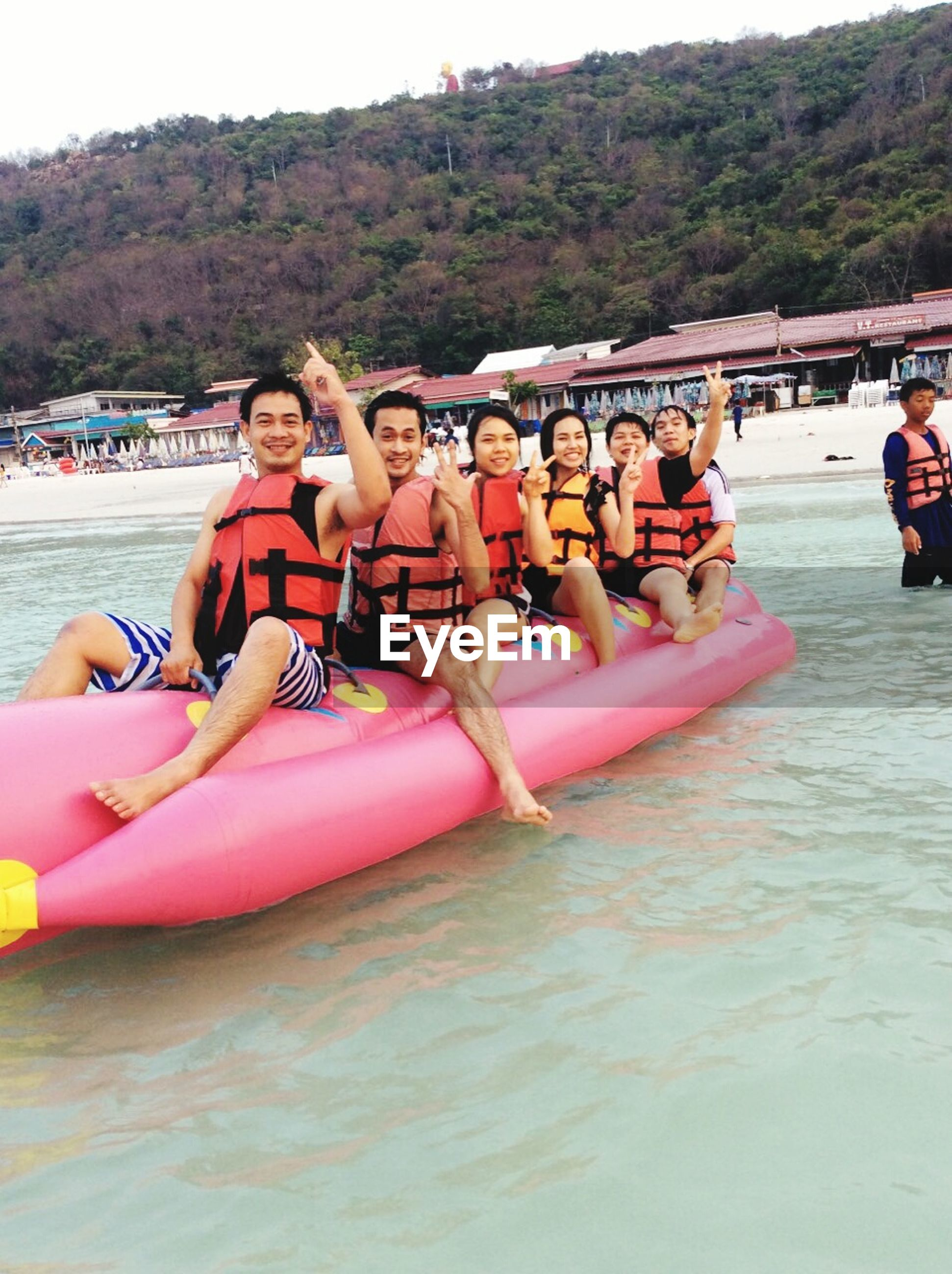 water, leisure activity, lifestyles, beach, vacations, mountain, sea, person, sand, incidental people, relaxation, tourist, day, sitting, outdoors, tourism, enjoyment, shore