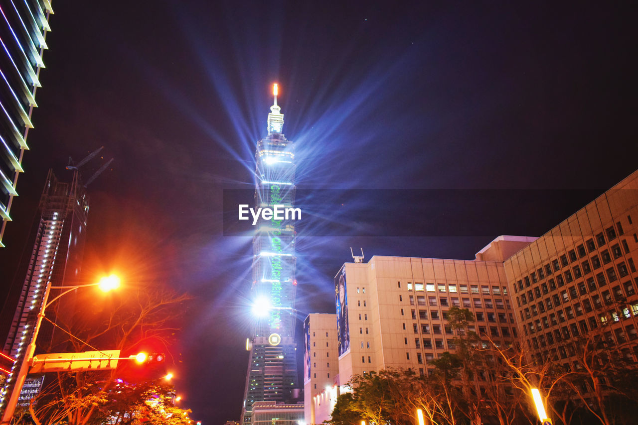 illuminated, architecture, built structure, building exterior, night, city, building, office building exterior, skyscraper, sky, low angle view, nature, no people, tall - high, light beam, lens flare, tower, office, travel destinations, outdoors, financial district