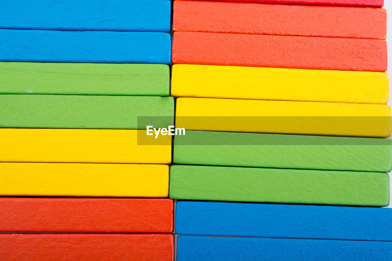 multi colored, yellow, variation, full frame, backgrounds, no people, pattern, art and craft, close-up, creativity, choice, paint, blue, red, vibrant color, green color, built structure, rainbow, wood - material, indoors, saturated color, coloring, color swatch, flag