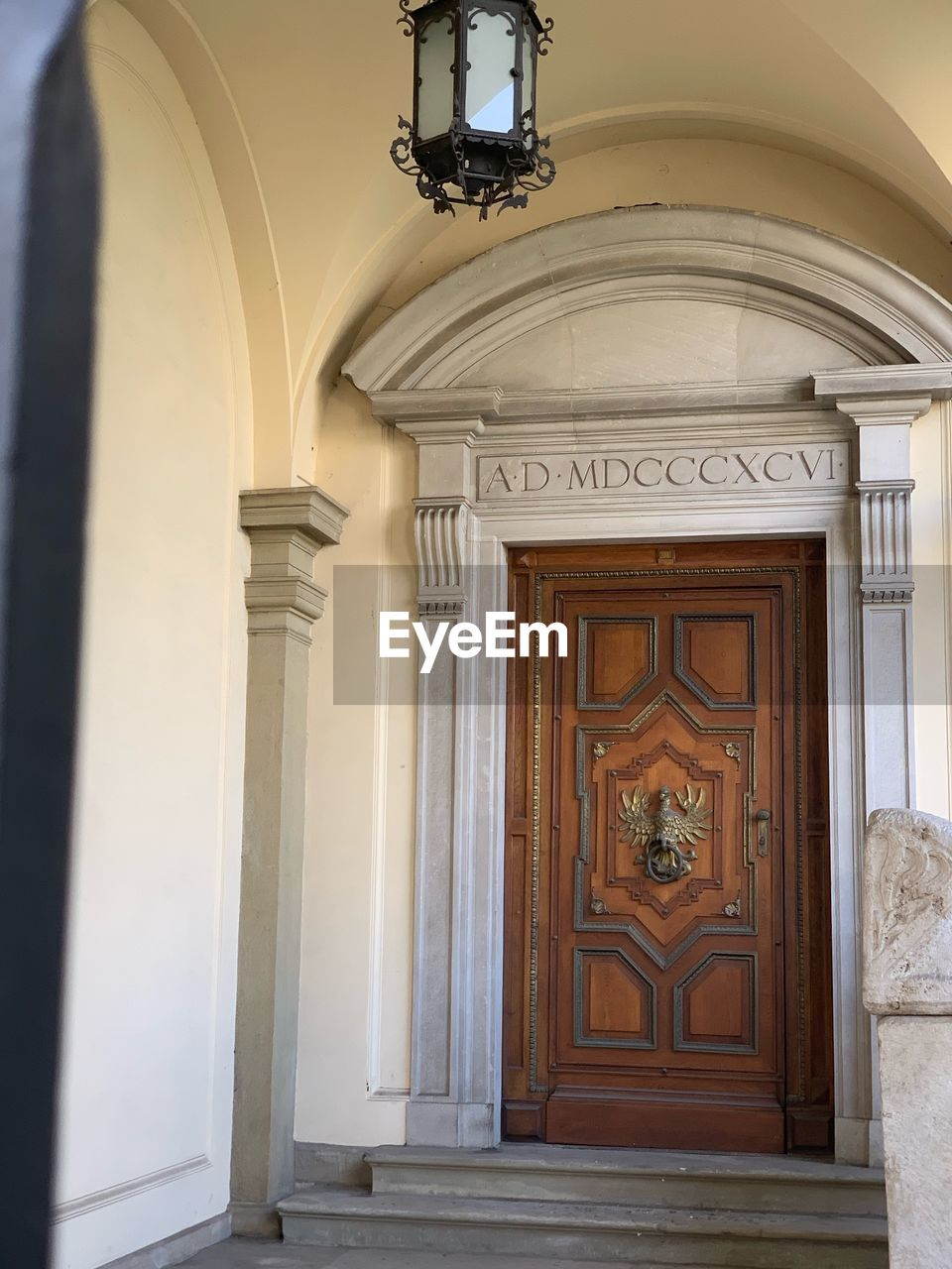 architecture, door, entrance, built structure, building, building exterior, no people, arch, day, architectural column, closed, house, the past, wall - building feature, lighting equipment, history, arcade, security, outdoors, ceiling, ornate