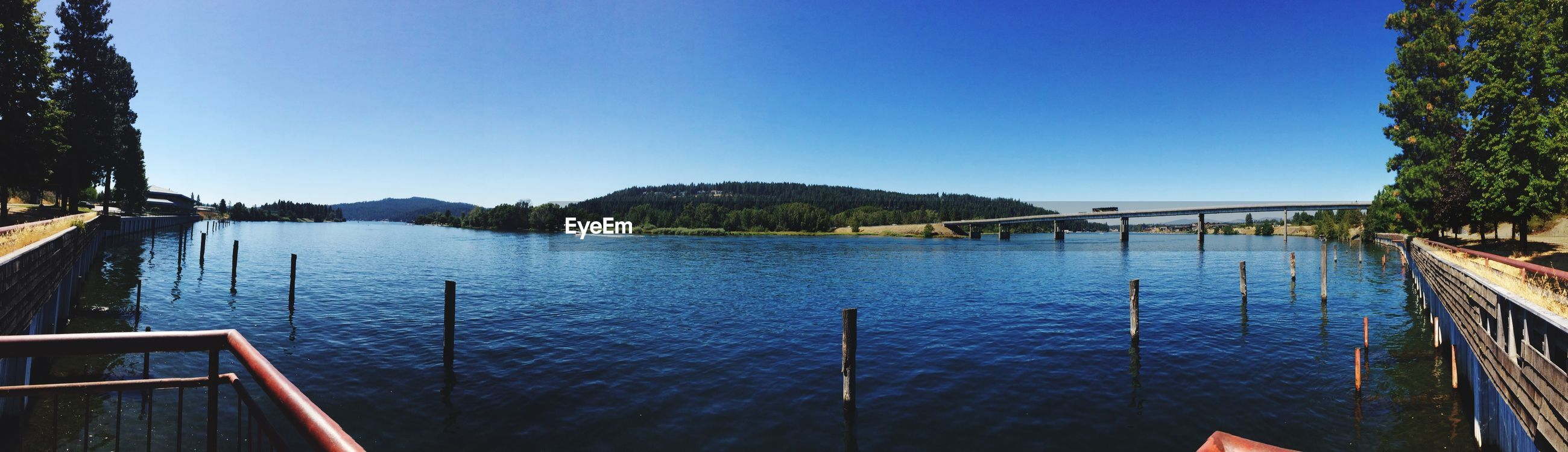 Panoramic view of river against clear blue sky