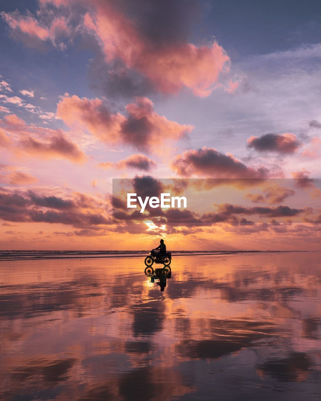 water, sky, sunset, cloud - sky, sea, scenics - nature, waterfront, beauty in nature, orange color, nautical vessel, mode of transportation, reflection, horizon over water, nature, transportation, real people, horizon, one person, silhouette, outdoors