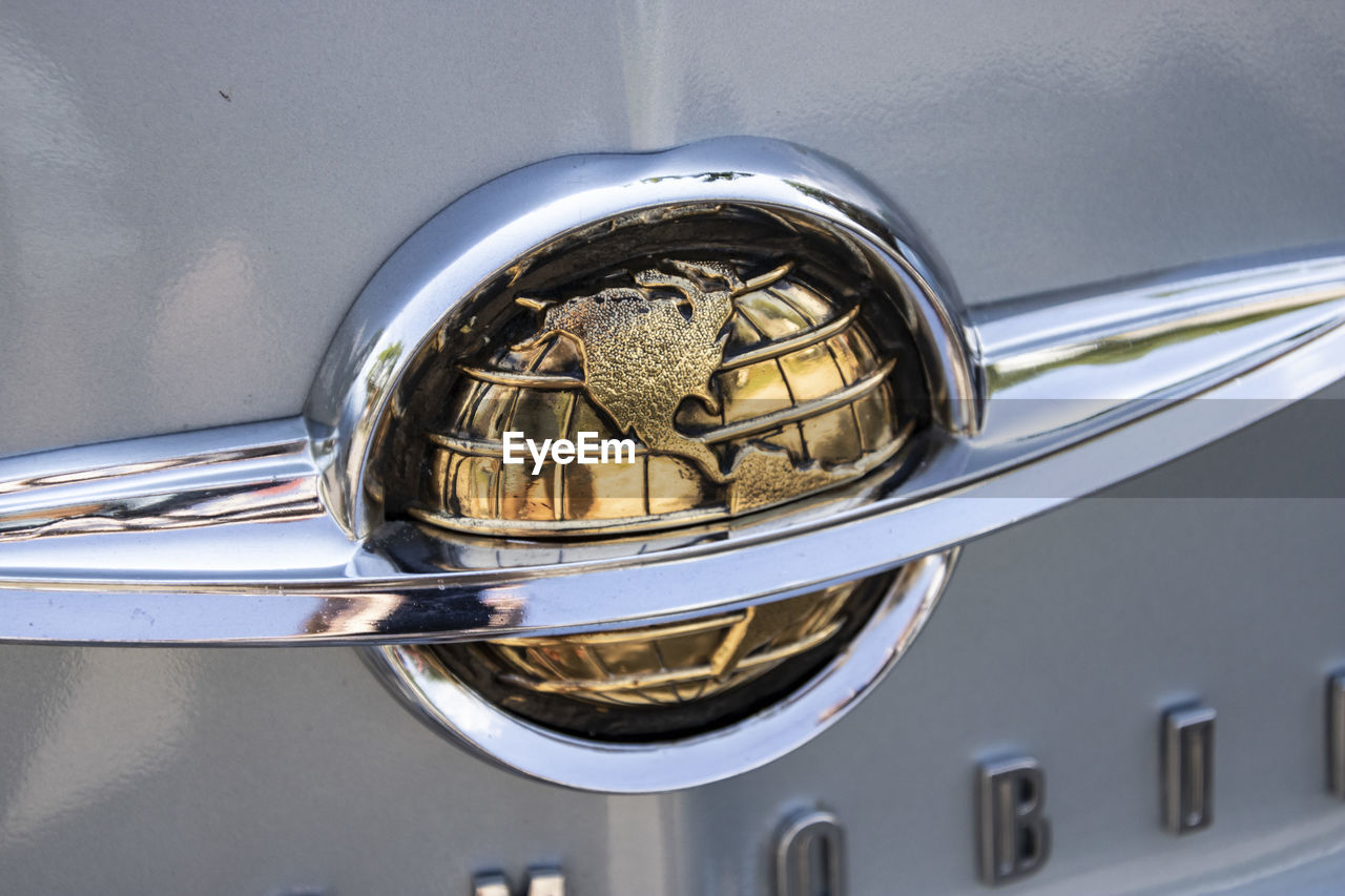 metal, close-up, shiny, gold colored, reflection, indoors, no people, silver colored, music, musical instrument, still life, day, car, land vehicle, mode of transportation, glass - material, alloy, motor vehicle, steel