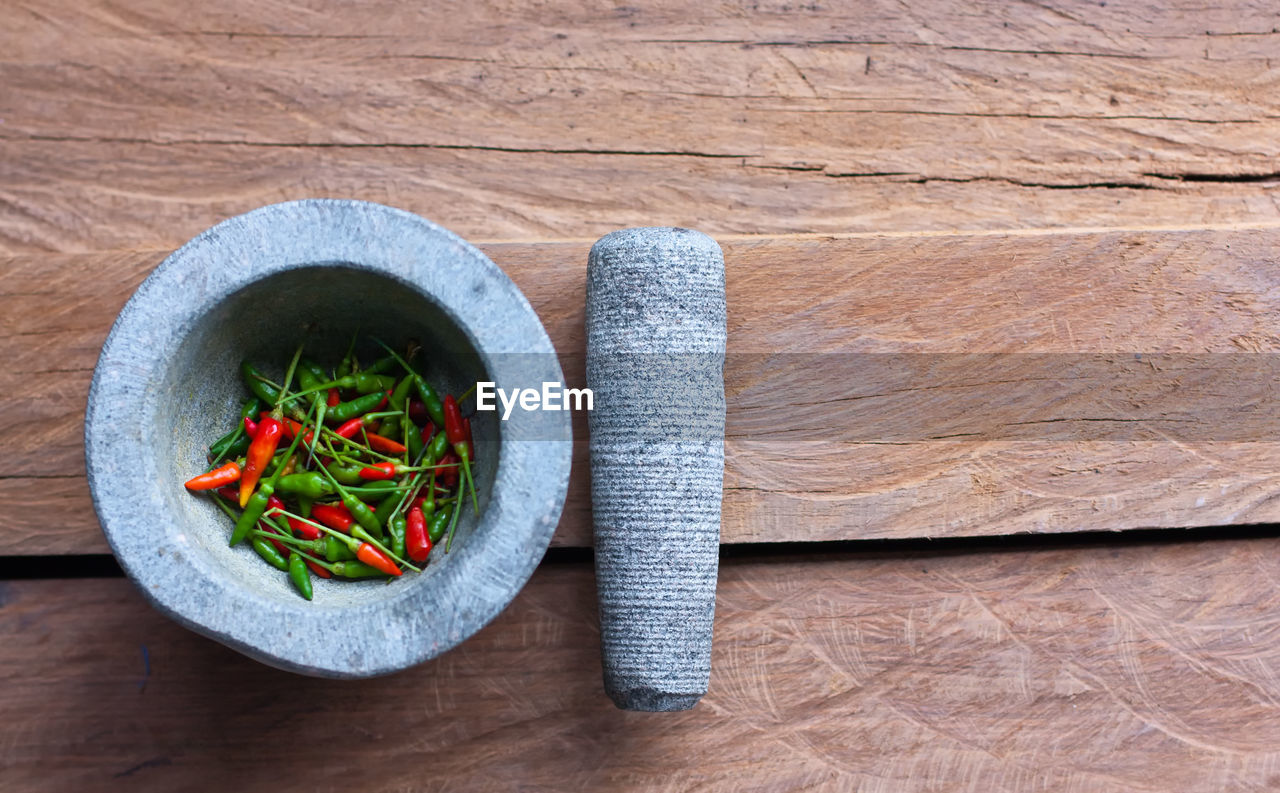 vegetable, healthy eating, food and drink, food, wellbeing, freshness, wood - material, bowl, indoors, high angle view, no people, directly above, spice, ingredient, table, healthy lifestyle, close-up, herb, household equipment, salad, vegetarian food, crockery, wood grain