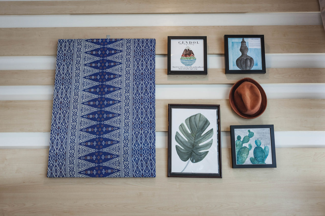 creativity, art and craft, no people, indoors, wood - material, craft, table, pattern, still life, side by side, shape, design, blue, variation, arrangement, wall - building feature, picture frame, representation, choice, close-up, floral pattern