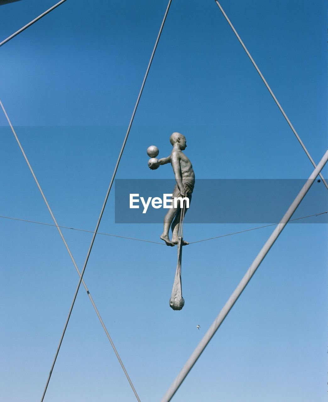 blue, low angle view, day, clear sky, cable, outdoors, no people, sculpture, sky