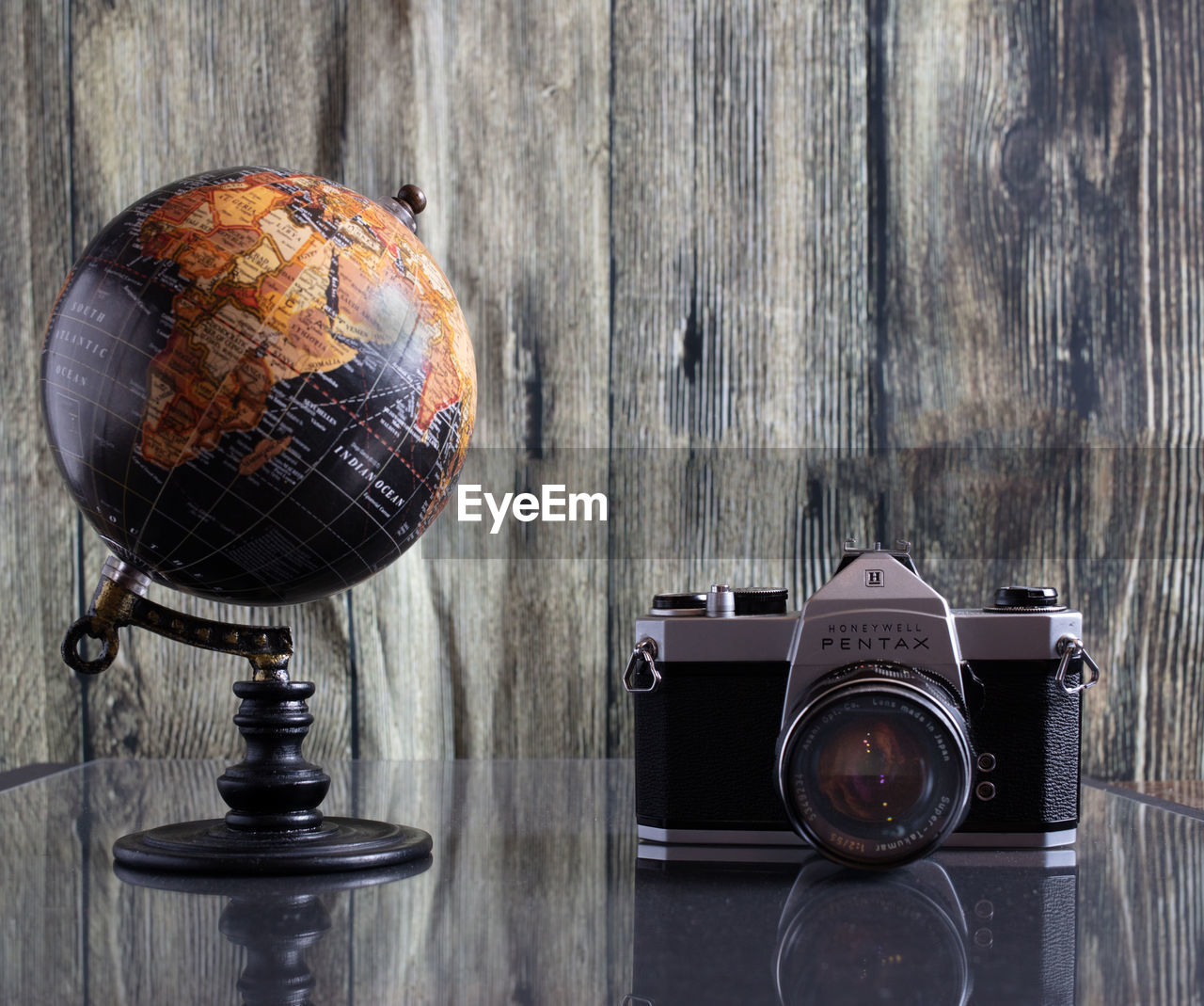 photography themes, wood - material, still life, camera - photographic equipment, table, retro styled, technology, indoors, no people, antique, photographic equipment, close-up, old, wall - building feature, globe - man made object, vintage, equipment, photographing, analog