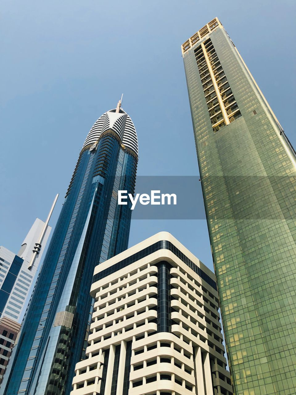 building exterior, built structure, architecture, building, office building exterior, tall - high, city, sky, low angle view, skyscraper, tower, modern, office, day, no people, clear sky, nature, travel destinations, sunlight, outdoors, financial district, spire, cityscape, high