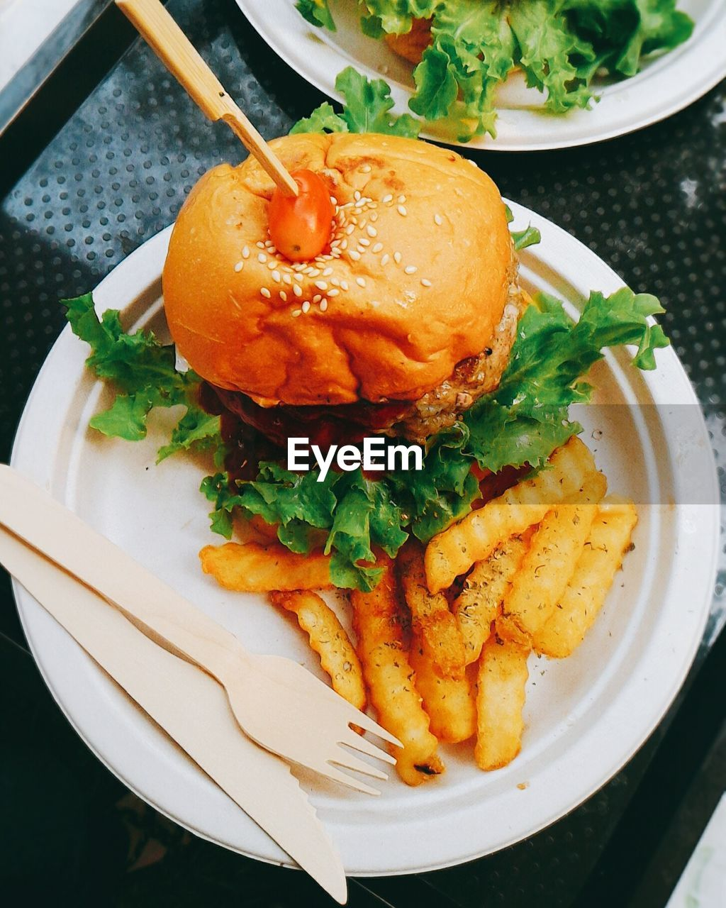 High Angle View Of Burger And French Fried In Plate