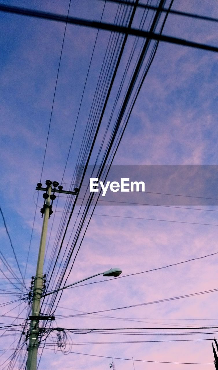 Low Angle View Of Cables Against Sky During Sunset
