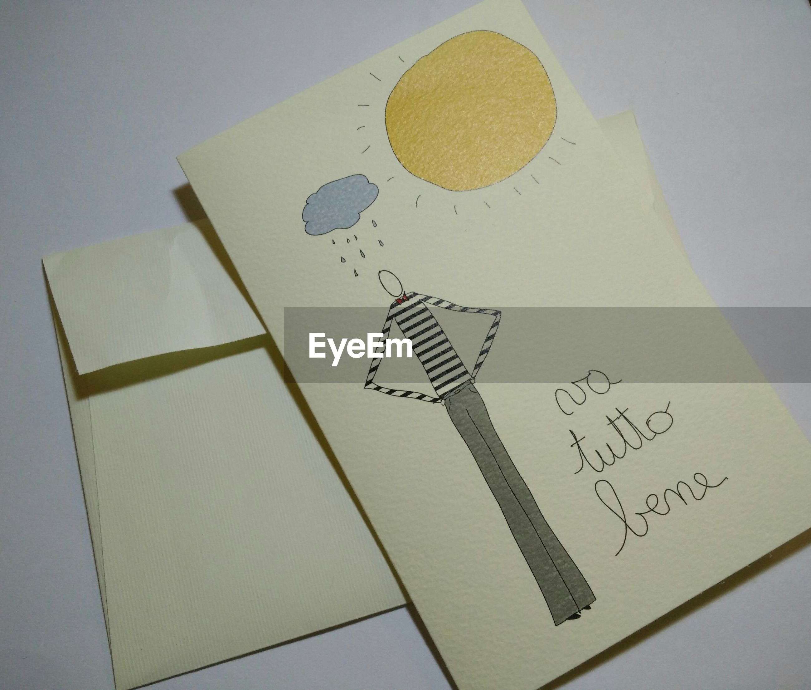 Close-up of greeting card on white surface
