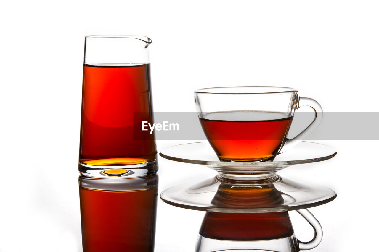 drink, refreshment, glass, white background, studio shot, drinking glass, food and drink, glass - material, indoors, still life, alcohol, household equipment, transparent, close-up, freshness, no people, shot glass, cup, tea, tea cup