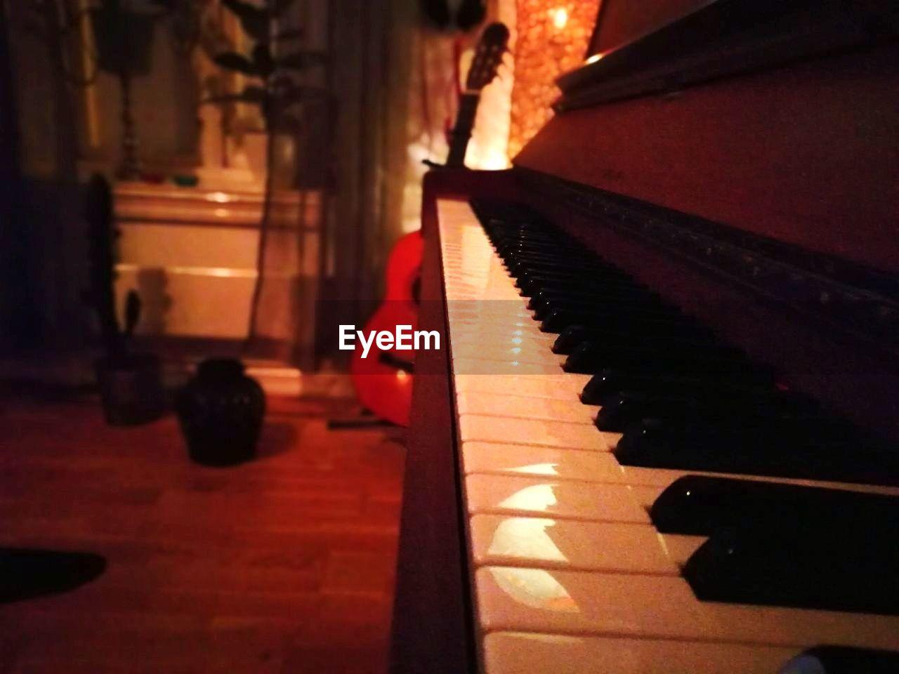 musical instrument, music, piano, indoors, piano key, no people, illuminated, close-up, day