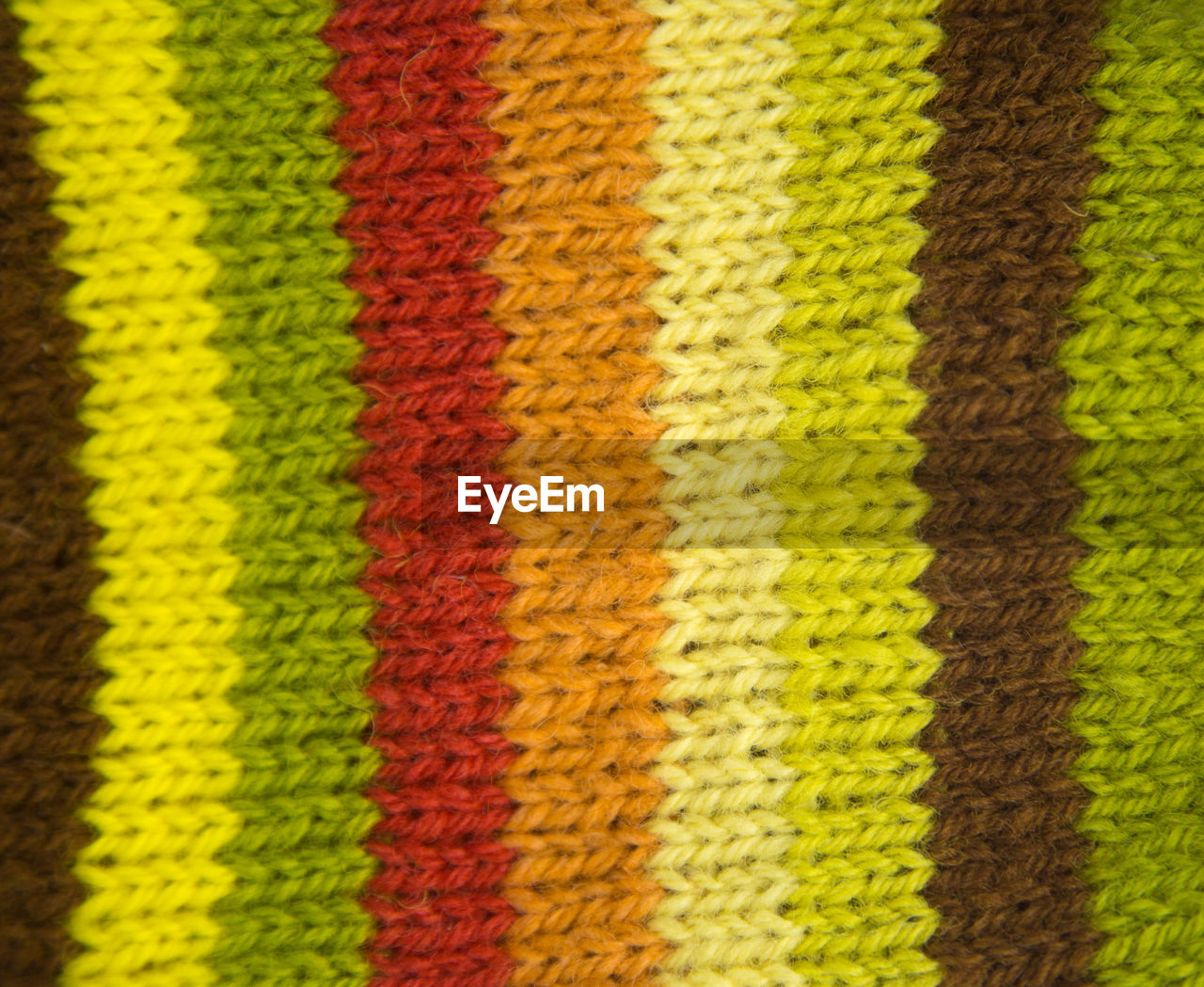 full frame, yellow, close-up, no people, backgrounds, pattern, multi colored, indoors, striped, textured, textile, focus on foreground, sport, high angle view, abstract, wool, design, selective focus, red, white color