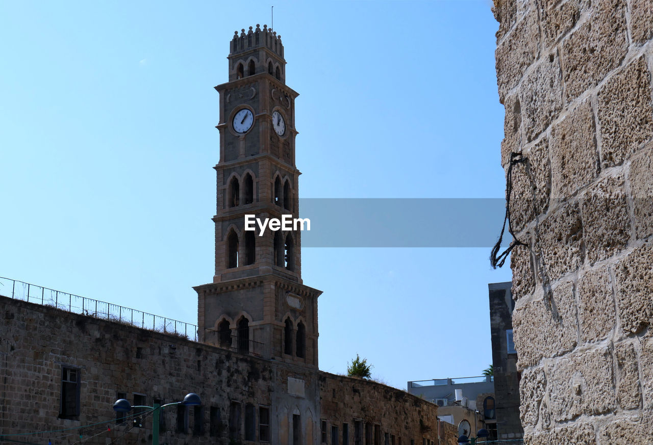 building exterior, architecture, built structure, sky, low angle view, building, place of worship, religion, spirituality, belief, clear sky, tower, the past, history, nature, day, travel destinations, no people, clock, stone wall