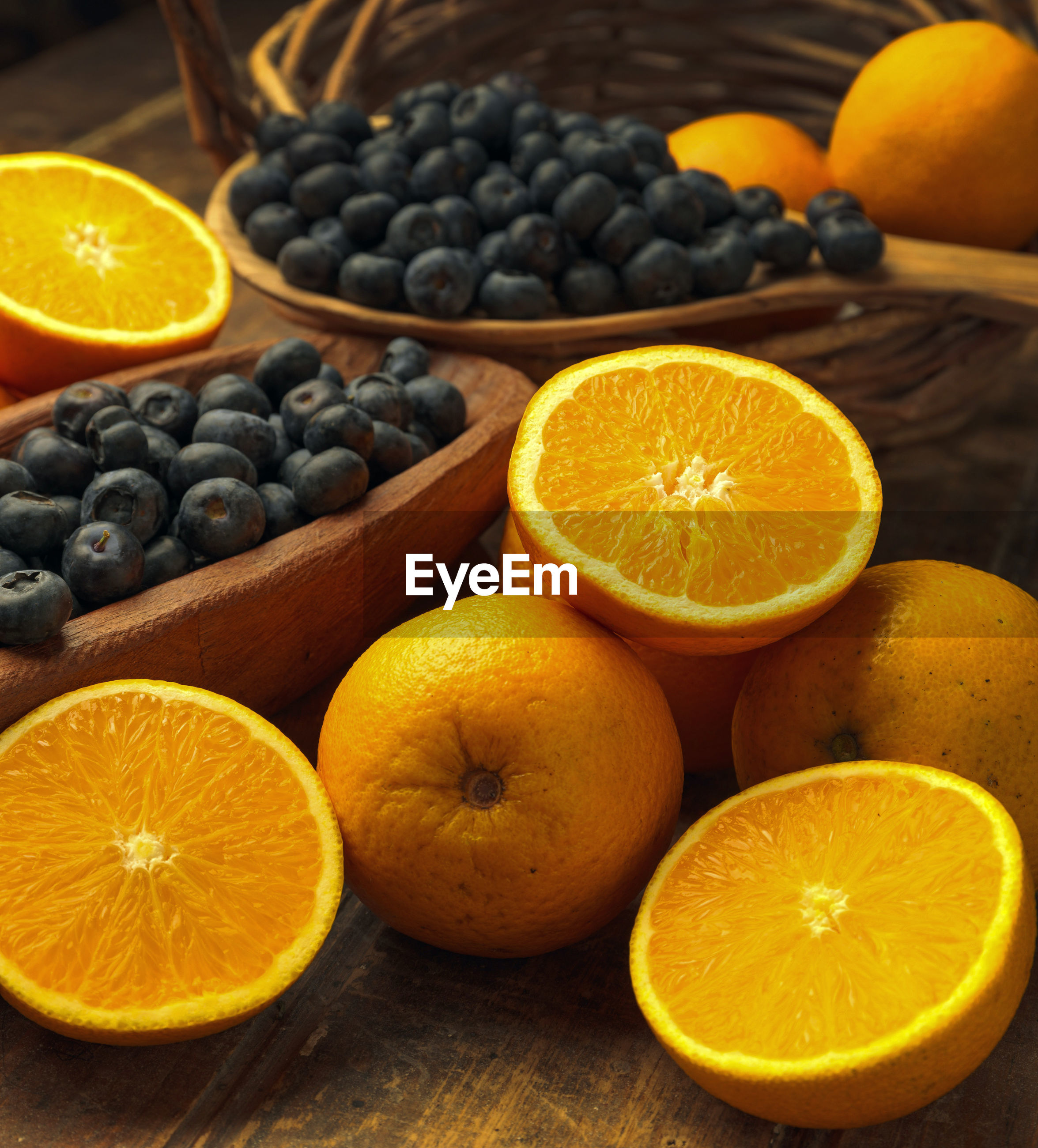 HIGH ANGLE VIEW OF FRUITS IN CONTAINER ON TABLE