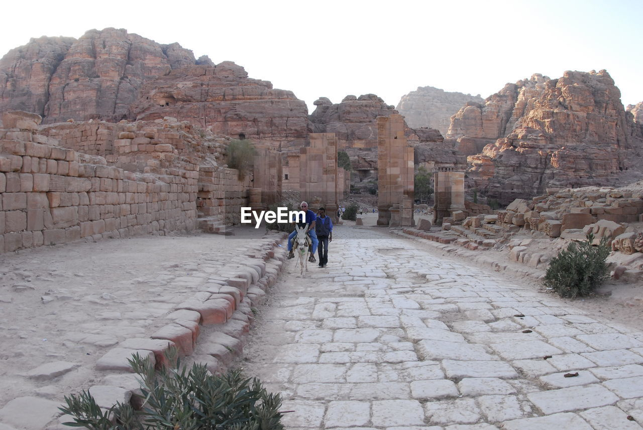 PEOPLE AT OLD RUINS