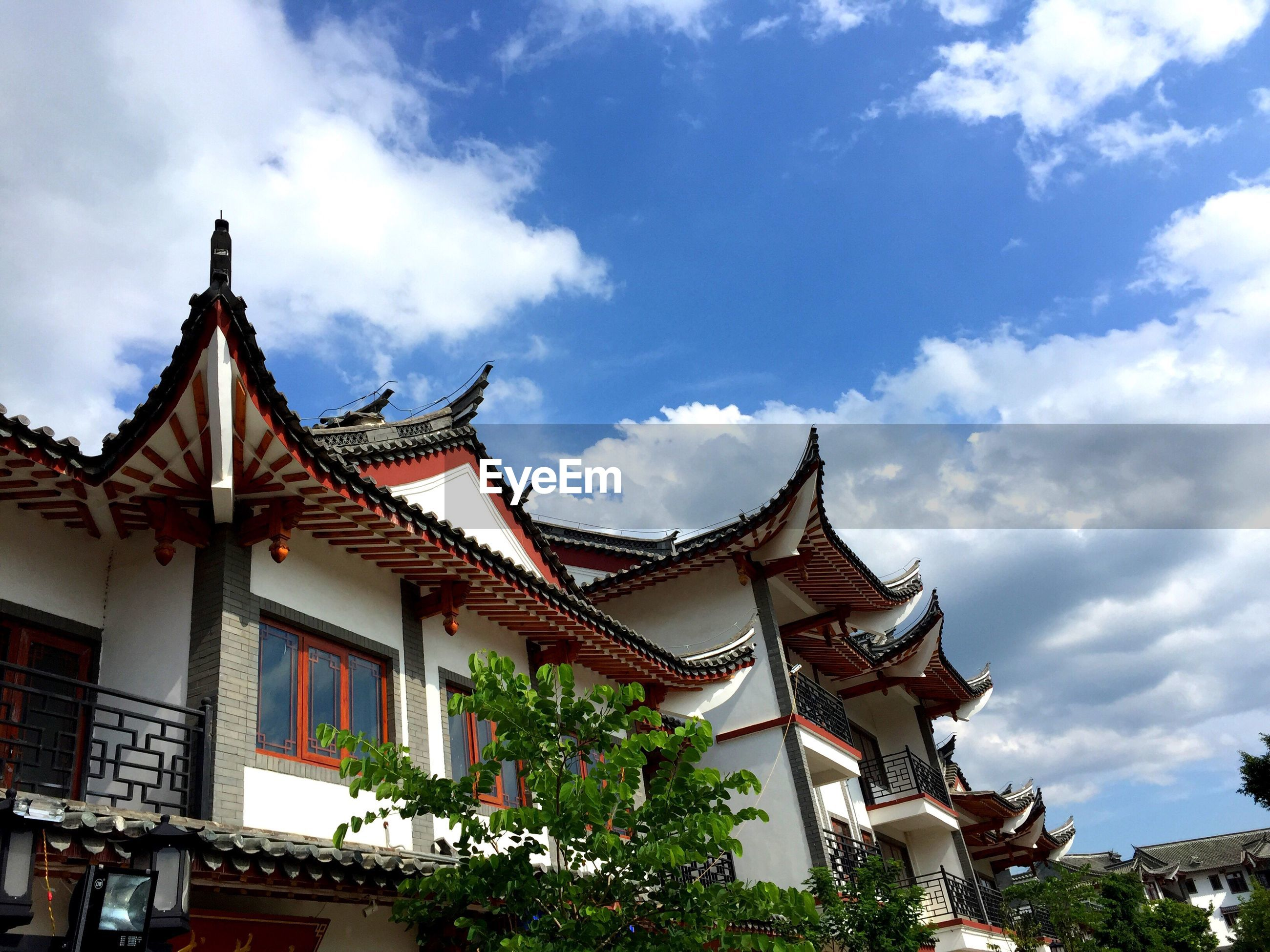 architecture, built structure, sky, low angle view, roof, cloud - sky, cloud, cloudy, day, outdoors, no people, ornate, architectural feature, nature, repetition