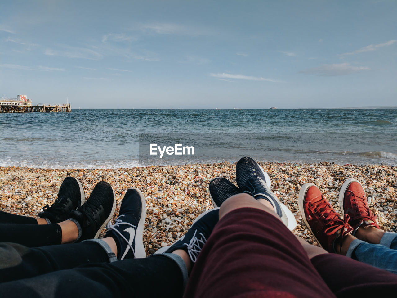 sea, water, sky, beach, horizon over water, low section, horizon, human leg, land, real people, scenics - nature, personal perspective, beauty in nature, shoe, body part, human body part, nature, lifestyles, leisure activity, outdoors