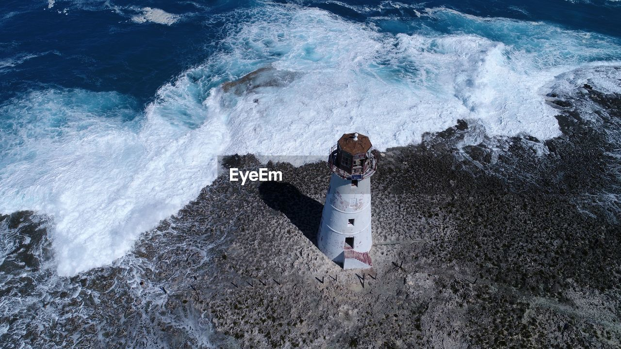 High angle view of lighthouse at coastline