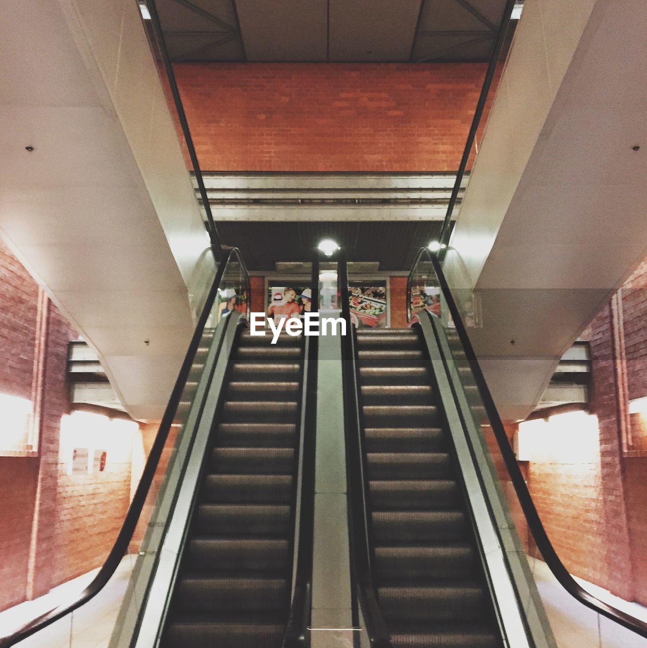 Escalators in building