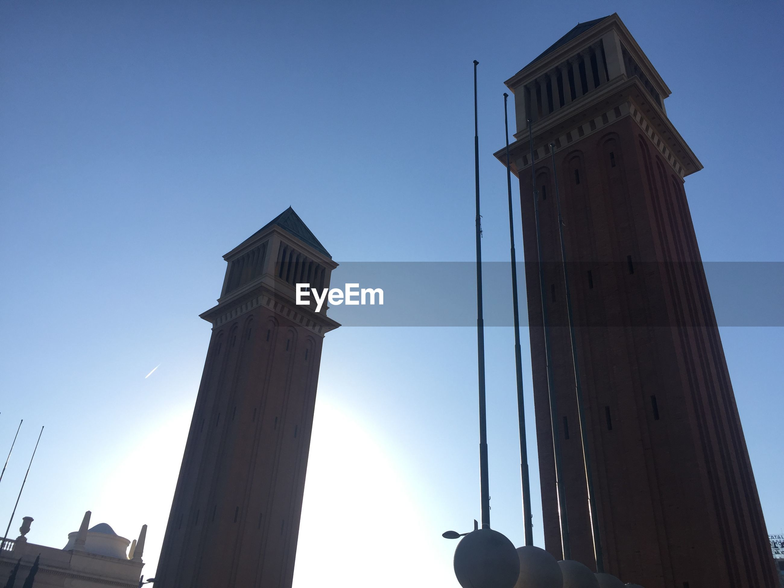 Low angle view of towers against clear sky