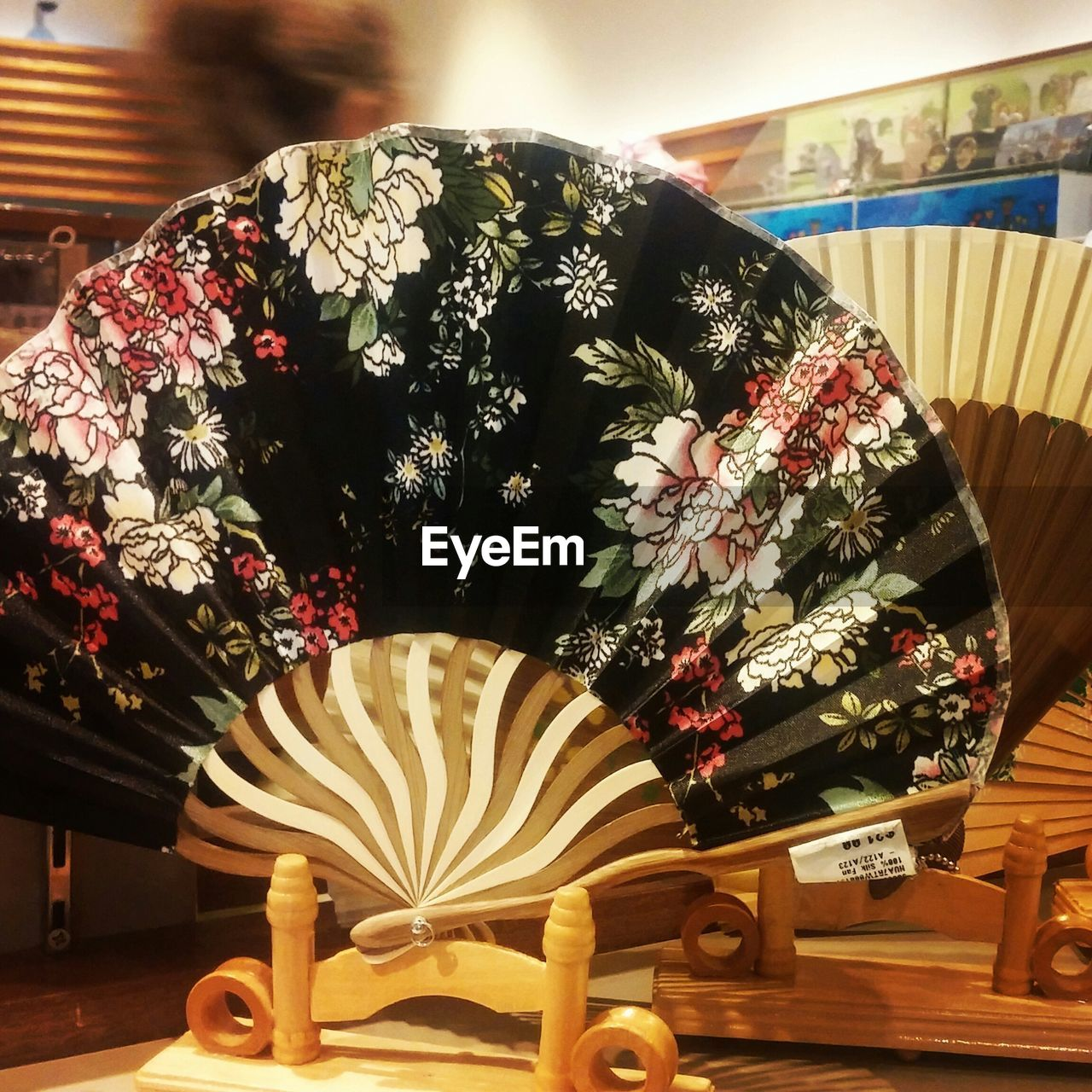 Close-Up Of Hand Fan On Table