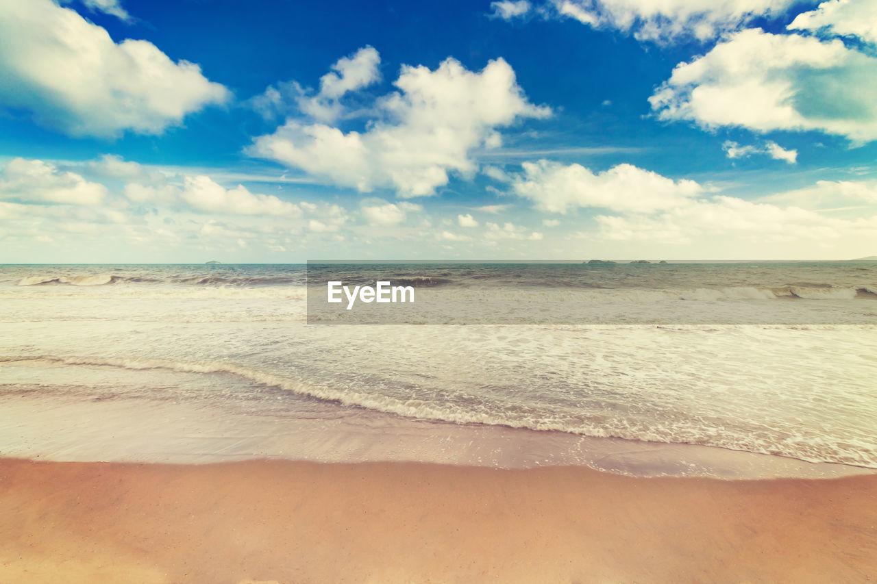 cloud - sky, sky, beach, land, sea, beauty in nature, scenics - nature, tranquil scene, horizon, water, sand, tranquility, horizon over water, nature, idyllic, day, aquatic sport, no people, non-urban scene, outdoors, salt flat