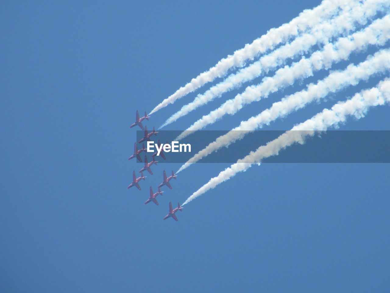 Low Angle View Of Airshow Against Clear Blue Sky